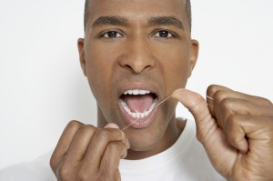 this attractive man likes to floss!