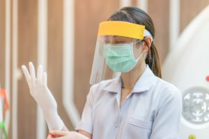 Salinas dentist wearing PPE in COVID-19 to prepare for appointment