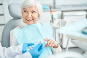 older woman fitted with implant dentures